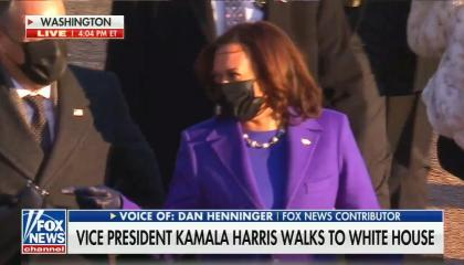 Live shot of Kamala Harris in purple suit walking with her family