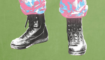 Solider wearing camo pants that are the color of the trans pride flag