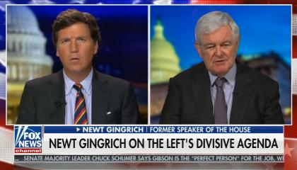"Tucker Carlson on left screen; Newt Gingrich on right screen; chyron reads ""Biden WH pushing most divisive issues possible"""