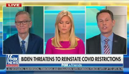 "Fox & Friends co-hosts Steve Doocy, Ainsley Earhardt, and Brian Kilmeade. Chyron reads ""Biden threatens to reinstate covid restrictions"" -- if the pandemic worsens, which the chyron does not mention."