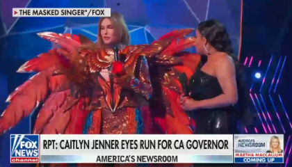 Caitlyn Jenner in a red feather outfit
