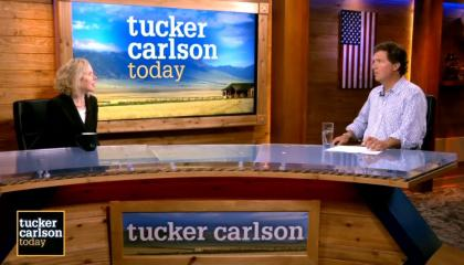 """Heather Mac Donald and Tucker Carlson sit across from each other in front of """"Tucker Carlson Today"""" logo"""