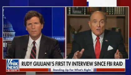 "Tucker Carlson on left, Rudy Giuliani on right; chyron reads: ""Rudy Giuliani's first TV interview since FBI raid"""
