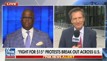 """chyron reads: """"Fight for $15"""" protests break out across U.S."""