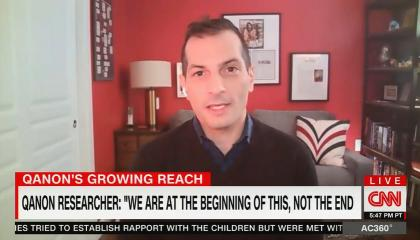 """Angelo Carusone addresses camera, chyron reads """"QAnon Researcher: We are at the beginning of this, not the end"""
