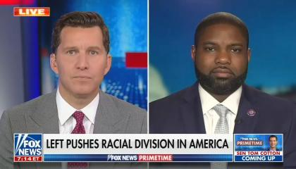 """Will Cain on left, Congressman Byron Donalds on left; chyron reads, """"Left pushes racial division in America"""""""