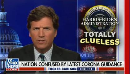 """Tucker Carlson addresses camera; photo in box of presidential seal with words, """"totally clueless"""" written across; chyron reads, """"Nation confused by latest corona guidance"""""""