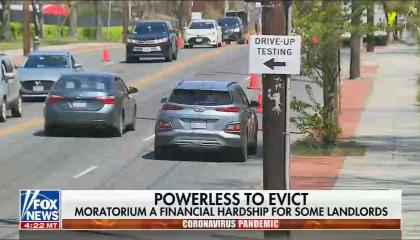 """Live video of cars on a street; chyron reads: """"Powerless to Evict. Moratorium a financial hardship for some landlords"""""""