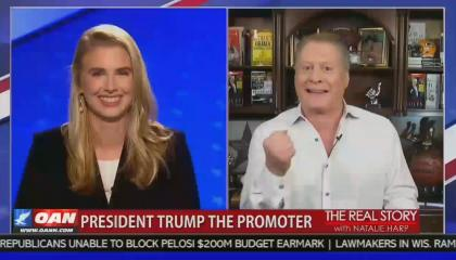 Wayne Allyn root joins OAN's the real story --raising fist while explaining why he wants to give the VP of the US, Kamala Harris, a beating