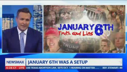 """Newsmax host calls the January 6 insurrection a """"set up"""" and a """"trap"""" for Trump supporters"""