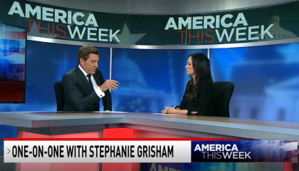 Eric Bolling sitting at America This Week desk with Stephanie Grisham