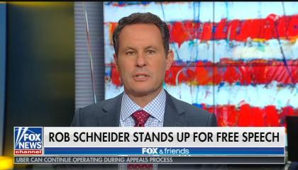 "Brian Kilmeade on a partial US flag background speaking above a chyron reading ""Rob Schneider stands up for free speech"""