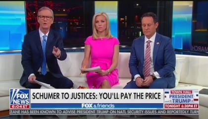 """Steve Doocy, Ainsley Earhardt, and Brian Kilmeade above a chyron reading """"Schumer to Justices: You'll Pay The Price"""""""