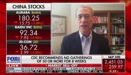 Author Gordon Chang on screen left, with stock updates amid coronavirus downturn on screen left