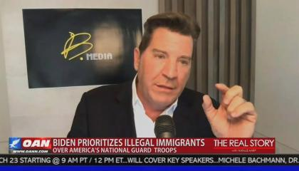 "Former Fox host and Sinclair anchor Eric Bolling appearing on One America News, pinching his fingers together, with chyron reading ""Biden prioritizes illegal immigrants over America's National Guard troops,"" with a confusingly identical background color to the show logo (The Real Story with Natalie Harp) to the right."