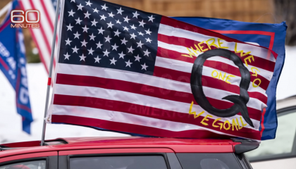 60 Minutes QAnon on the US flag screenshot