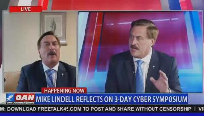 """An OAN screenshot of MyPillow CEO Mike Lindell doing a remote interview on screen left, with screen right showing larger file footage of Lindell in a different OAN interview. Chyron reads """"Mike Lindell reflects on 3-day Cyber Symposium"""""""