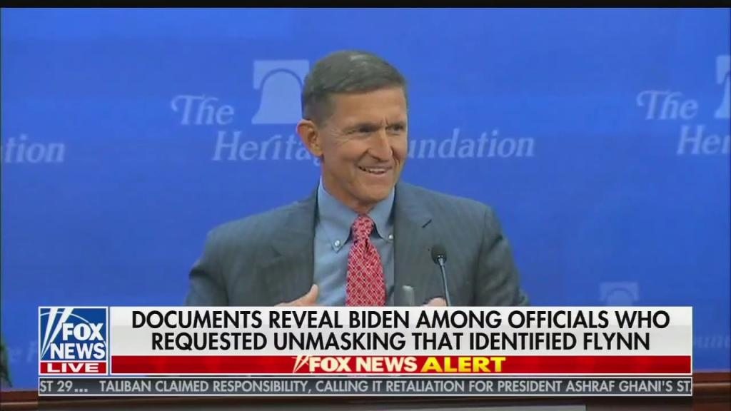 "A file image of Lt. Gen. Michael Flynn at a Heritage Foundation event, with chyron reading ""Documents reveal Biden among officials who requested unmasking that identified Flynn"""