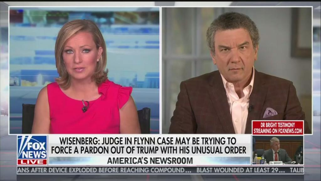 "Anchor Sandra Smith and guest Sol Wisenberg with a chyron reading ""Wisenberg: Judge in Flynn case may be trying to force a pardon out of Trump with his unusual order"""