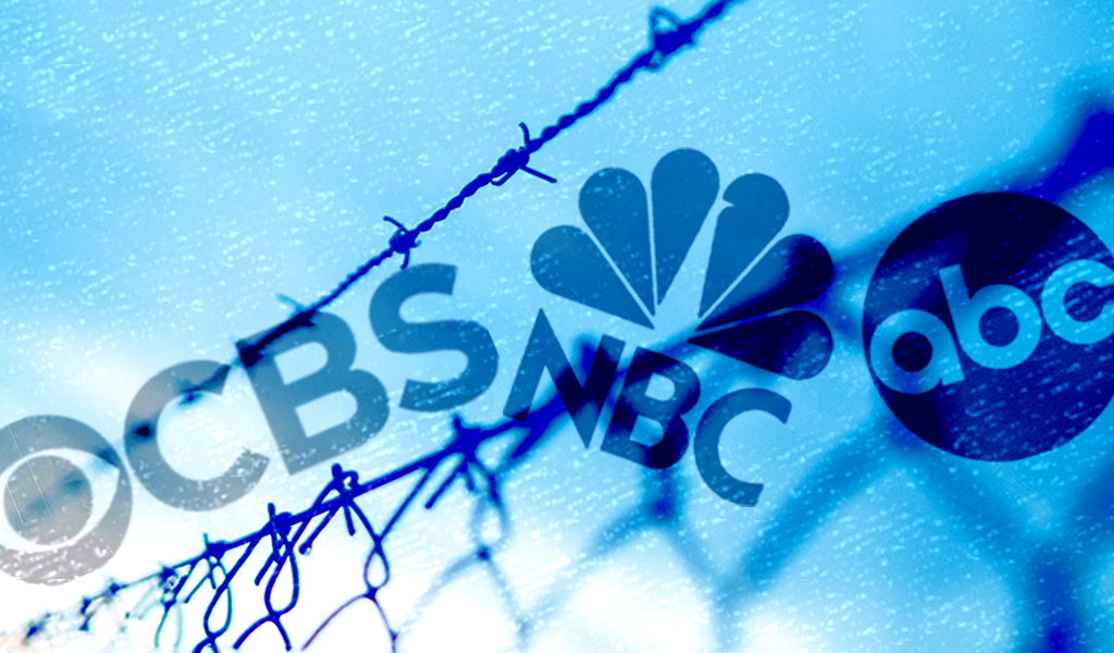 Border fence with broadcast network logos
